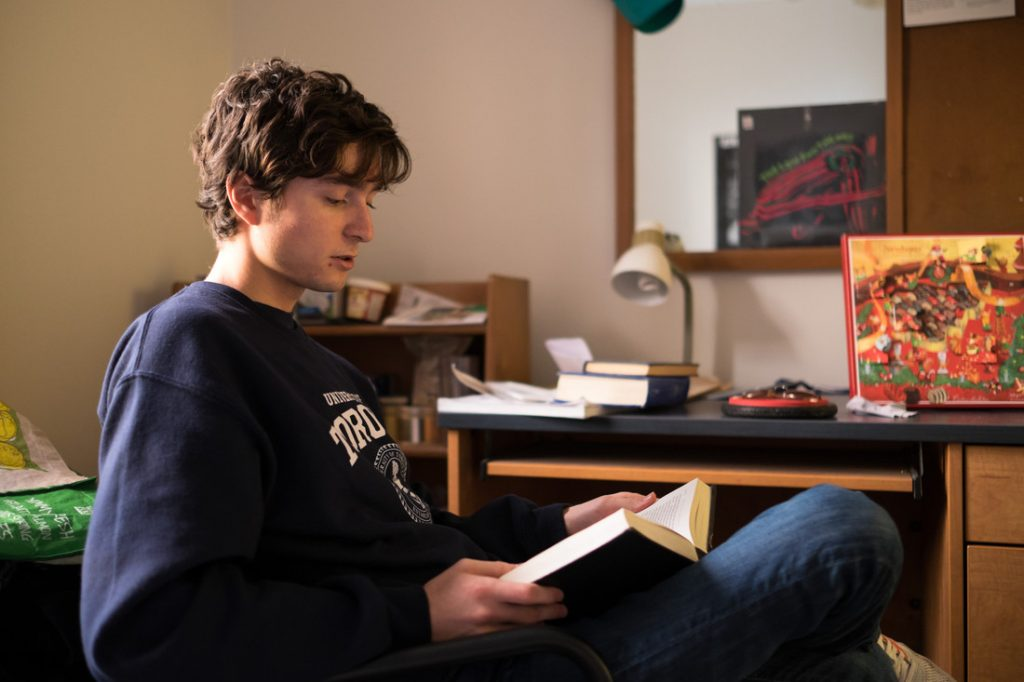 Venizelos, a first-year student from Connecticut, studying in his dorm room at Sir Daniel Wilson Residence.