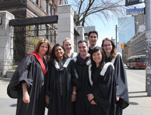 Group of graduating students and faculty members