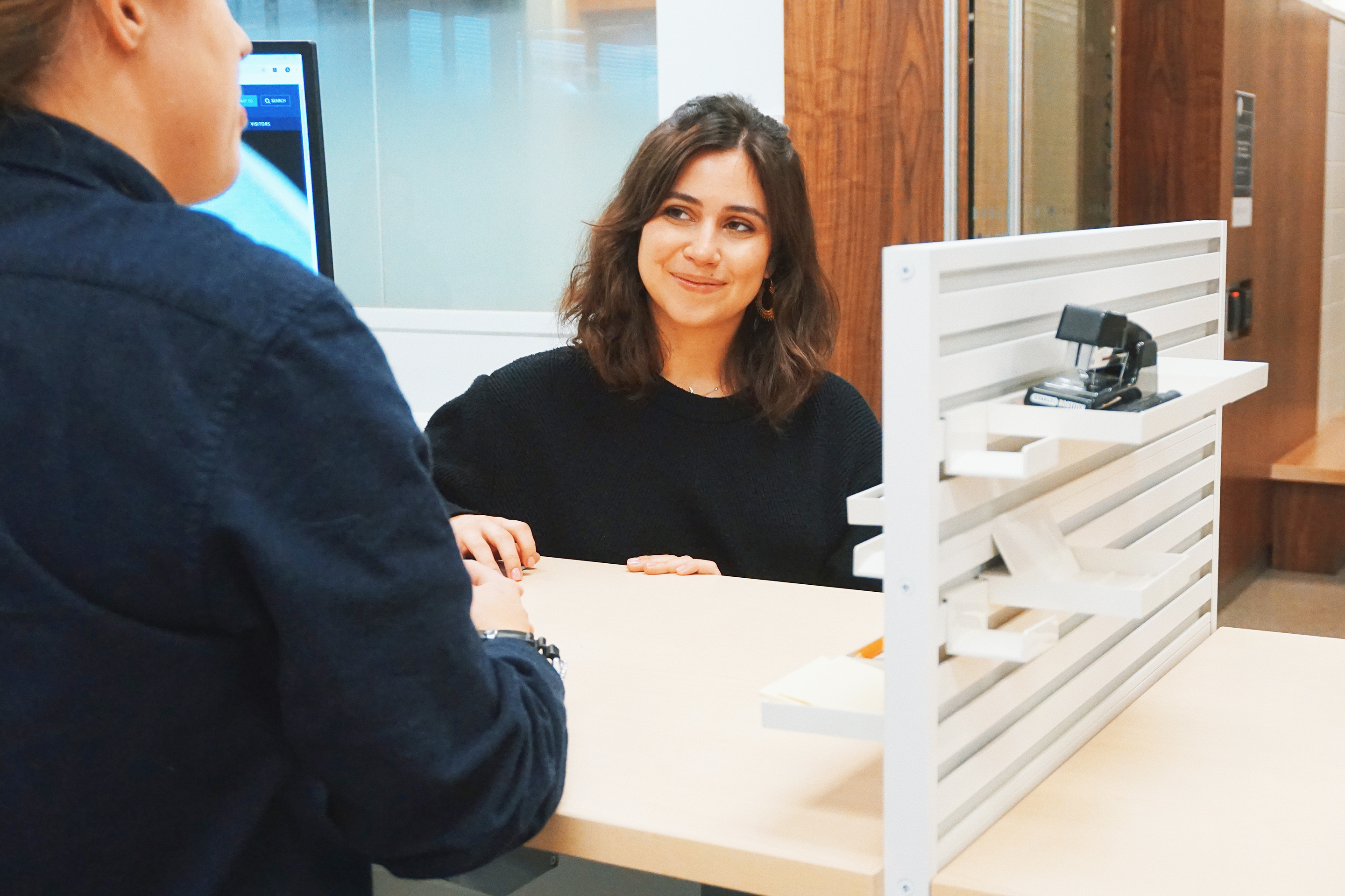 Photo of a female student talking to a registrar