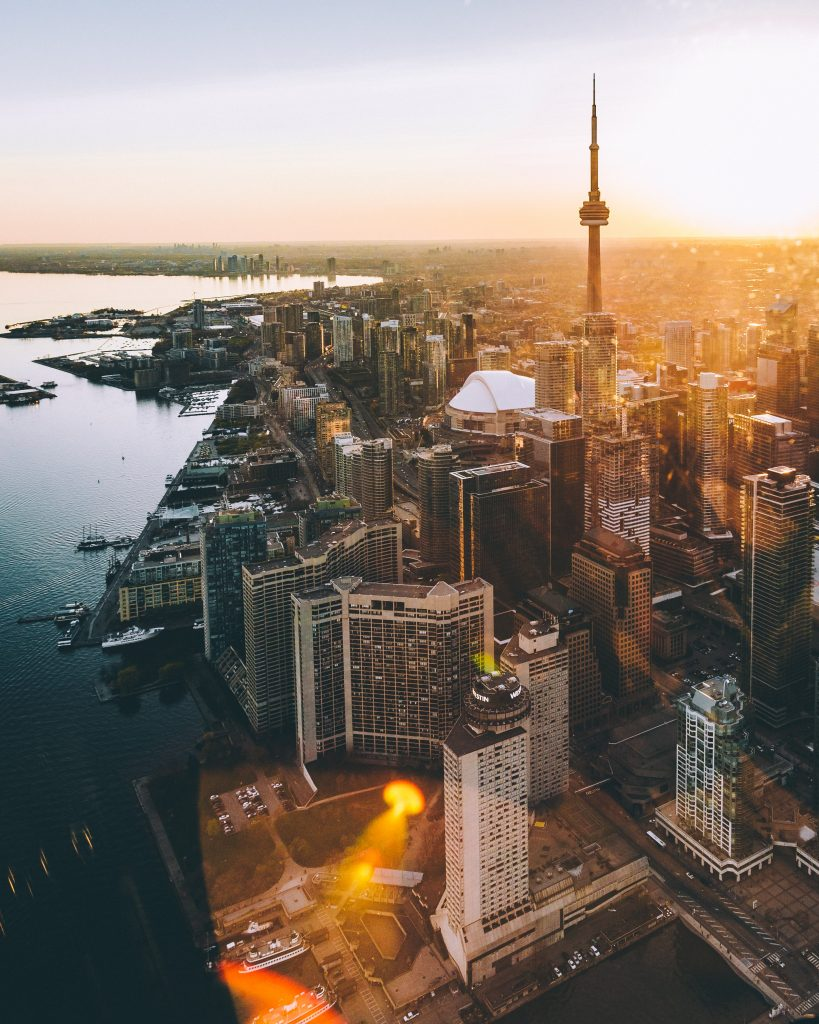 Aerial photo of Toronto with the CN Tower and Lake Ontario in the foreground.